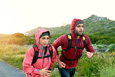 Buy stock photo Cropped shot of a young couple out for a morning run