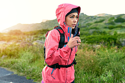 Buy stock photo Cropped shot of an attractive young female athlete out for a morning run