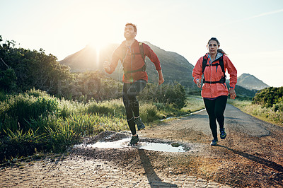 Buy stock photo Full length shot of a young couple out for a morning run