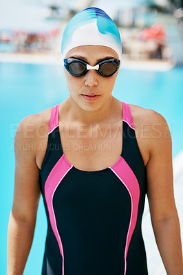 Buy stock photo Cropped portrait of a young female swimmer in full swimming gear