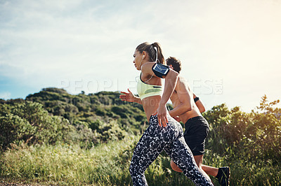 Buy stock photo Cropped shot of a young couple out for their morning run