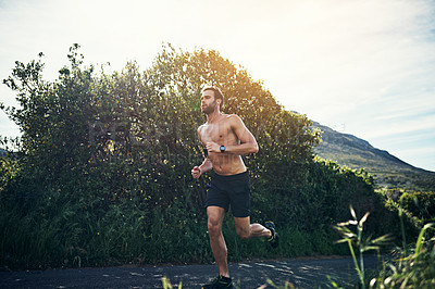 Buy stock photo Full length shot of a handsome young male athlete out for a morning run