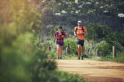 Buy stock photo Rearview shot of a young athletic couple out for their morning run
