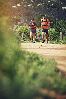 Buy stock photo Full length shot of a young athletic couple out for their morning run