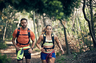Buy stock photo Cropped shot of a young athletic couple out for their morning run