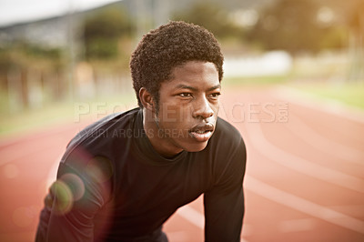 Buy stock photo Cropped shot of a young man out on the track