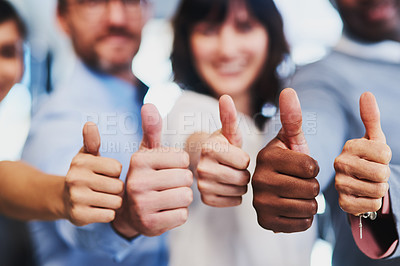 Buy stock photo Closeup shot of a group of unrecognizable businesspeople showing thumbs up in an office