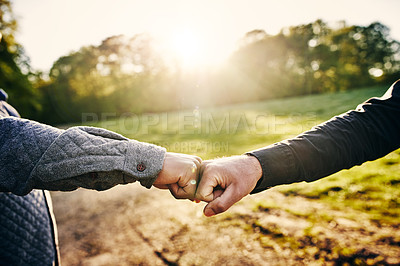 Buy stock photo Cropped shot of two unrecognizable men fist bumping while team building at a company retreat