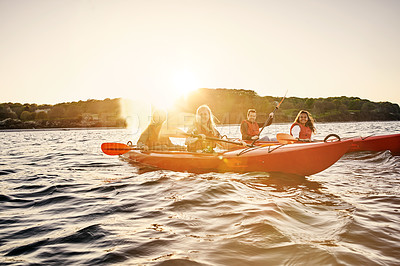 Buy stock photo Full length shot of a group of diverse colleagues canoeing as part of their company's team building retreat