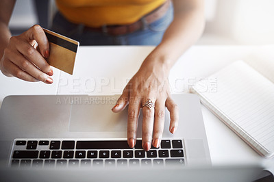 Buy stock photo High angle shot of an unrecognizable female designer using a laptop in her home office