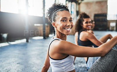 Buy stock photo Shot of a group of happy young women taking a break together at the gym
