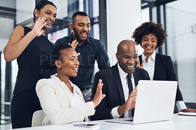 Buy stock photo Shot of a group of businesspeople using a laptop to make a video call during a boardroom meeting