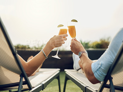 Buy stock photo Rearview shot of an unrecognizable couple toasting while relaxing outdoors