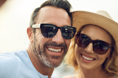 Buy stock photo Cropped portrait of an affectionate mature couple taking selfies outdoors