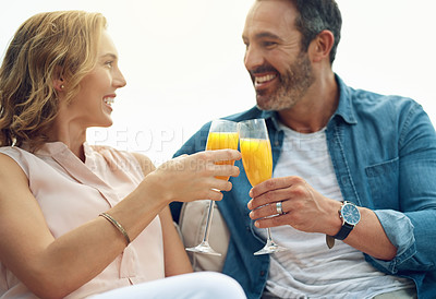 Buy stock photo Cropped shot of an affectionate mature couple toasting while relaxing outdoors