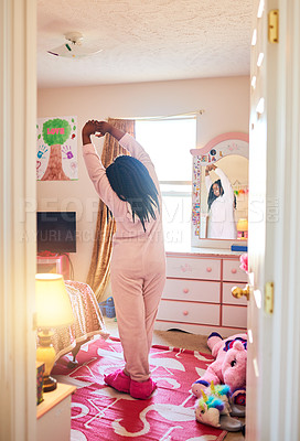 Buy stock photo Rearview shot of an unrecognizable little girl stretching in her bedroom