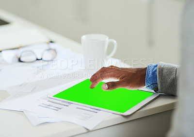 Buy stock photo Closeup shot of an unrecognizable man using a digital tablet with a green screen at home