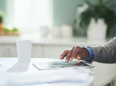 Buy stock photo Closeup shot of an unrecognizable man using a digital tablet at home