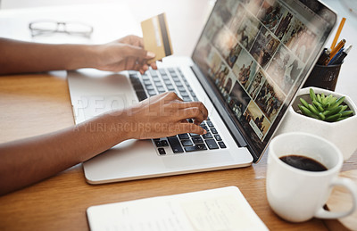 Buy stock photo Cropped shot of an unrecognizable woman shopping online in her home office