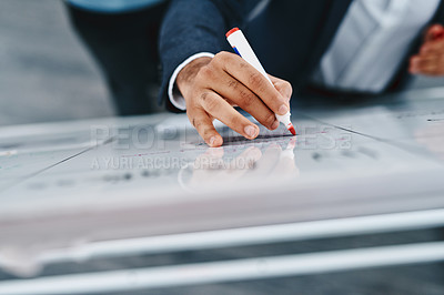 Buy stock photo Closeup shot of an unrecognizable businessman writing notes on a whiteboard in an office