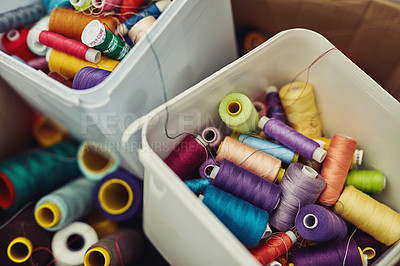 Buy stock photo Shot of multi-colored sewing cotton rolls