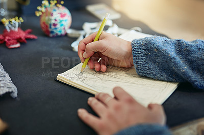 Buy stock photo Shot of a designer busy sketching in her workshop