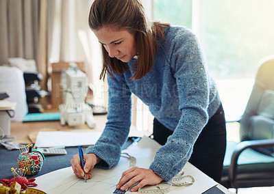 Buy stock photo Cropped shot of a designer drawing up patterns for her design