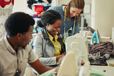 Buy stock photo Shot of fashion designers working in a workshop