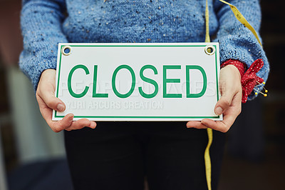 Buy stock photo Closeup shot of a young business owner holding an closed sign