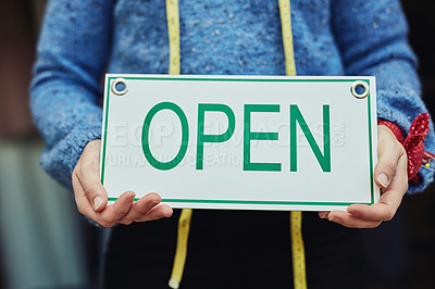 Buy stock photo Closeup shot of a young business owner holding an open sign