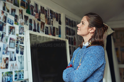 Buy stock photo Cropped shot of a fashion designer looking at her wall of inspiration