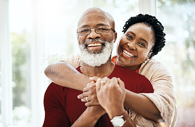 Buy stock photo Shot of a happy mature couple in a loving embrace at home