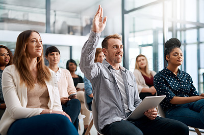 Buy stock photo Shot of a young man raising his hand to ask a question during a conference