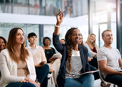 Buy stock photo Shot of a young woman raising her hand to ask a question during a conference