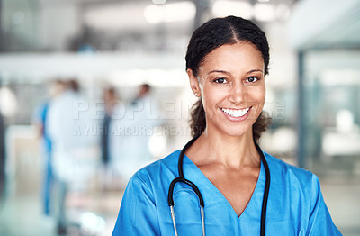 Buy stock photo Cropped portrait of an attractive female nurse standing in the hospital