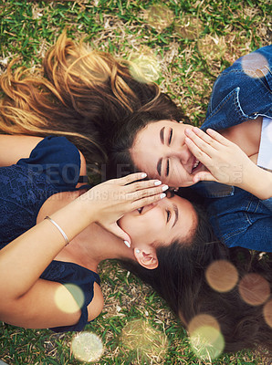 Buy stock photo High angle shot of two female best friends spending the day in a public park