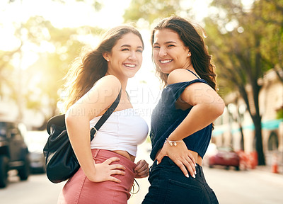 Buy stock photo Rearview shot of two female best friends spending the day in the city