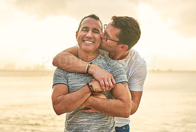 Buy stock photo Cropped shot of an affectionate mature couple spending the day by the beach