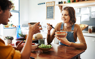 Buy stock photo Cropped shot of a young couple spending the day at home