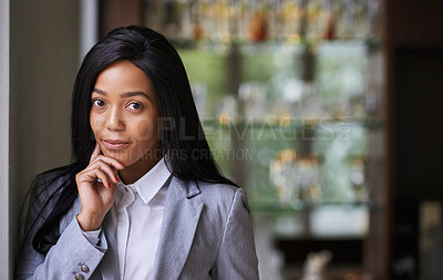 Buy stock photo Portrait of an ambitious young businesswoman in a bar