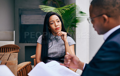 Buy stock photo Shot of a young businesswoman and businessman having a discussion outdoors