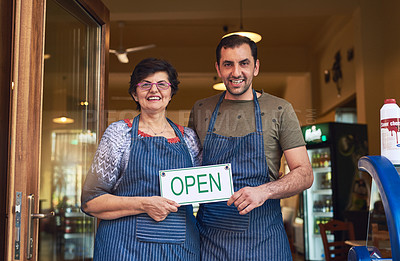 Buy stock photo Cropped portrait of a mature woman and her adult son standing in the entrance way to their family ice cream shop