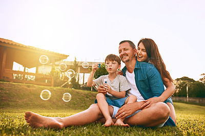 Buy stock photo Cropped shot of a young family spending time together outdoors