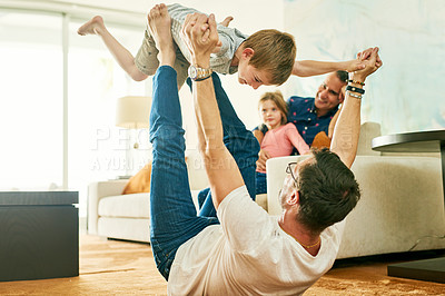 Buy stock photo Cropped shot of an adorable little boy playing with his father at home
