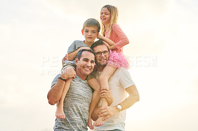 Buy stock photo Low angle portrait of an affectionate mature couple carrying their kids on their shoulders outside