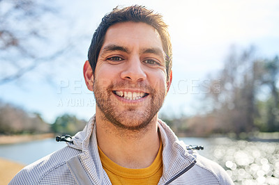 Buy stock photo Portrait of a handsome young man spending some time outdoors