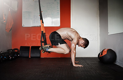 Buy stock photo Full length shot of a handsome and muscular young man working out in the gym