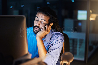 Buy stock photo Shot of a young designer sleeping at his desk during a late night at work