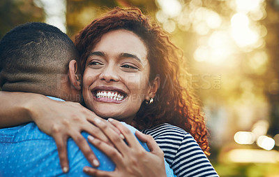 Buy stock photo Shot of a happy young couple embracing in the park