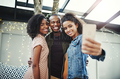 Buy stock photo Shot of a group of friends taking a selfie together on their night out